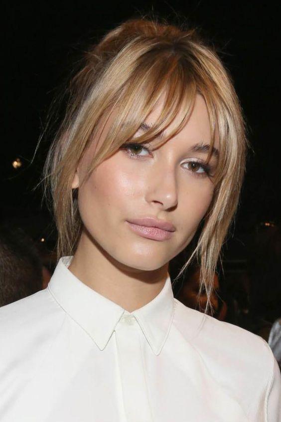 Cortes de cabello para adelgazar los cachetes - Flecos asimétricos